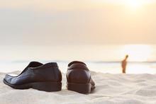 Black Man Leather Shoe On The Beach