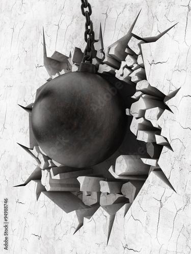 Fototapeta Wrecking ball demoslishes the wall obraz na płótnie