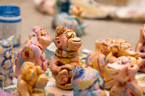 Photo  Painted Colorful Handmade Clay figurines of monkeys