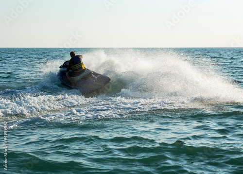 Poster Nautique motorise Silhouette of man on jetski at sea