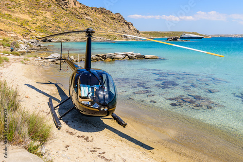 Small private helicopter on the beach of Paros island, Cyclades, Greece.