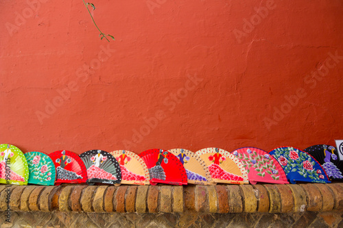 Photo  Fans Andalusian of colors on a red background