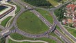 AERIAL: Flying above big highway roundabout junction full of cars