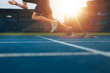 Runner Launching Off The Start Line