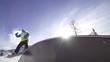 SLOW MOTION: Snowboarder rides a rainbow box