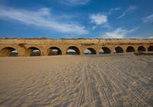 Ancient Aqueduct Between Sand And Skies