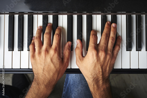 a man playing the piano Canvas Print