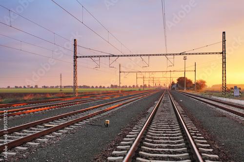 Foto op Canvas Spoorlijn Railroad at sunset
