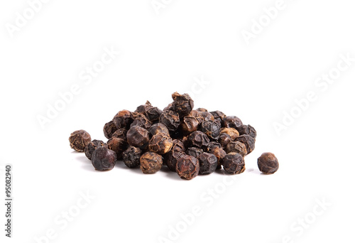 Fotografía  Black pepper on white background