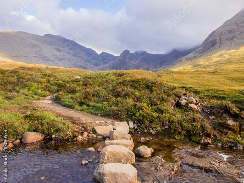 Fotografie, Obraz  Stepping stones leading to the Fairy Pools, Ilse of Skye, Scotland, UK
