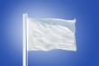 White flag flying against clear blue sky