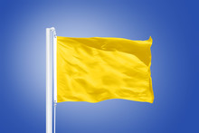 Yellow Flag Flying Against Clear Blue Sky