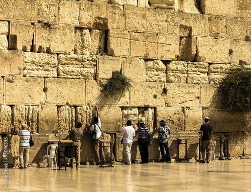Fotobehang Midden Oosten Unidentified jewish worshipers pray at the Wailing Wall an important jewish religious site. Jerusalem. Israel