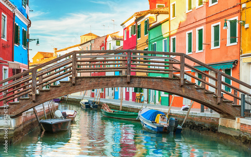 obraz lub plakat Small wooden bridge over a canal in Burano, Italy.