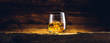 Leinwandbild Motiv Whiskey glass on the old wooden table
