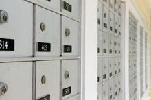 Closeup Of Rows Of Locked Metal Apartment Or Condominium Mailboxes