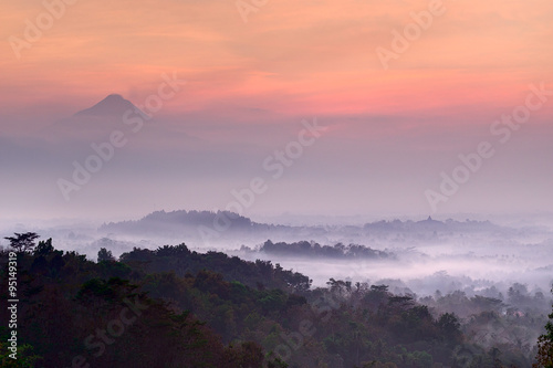 Photo  Pre-dawn at Setumbu hill with the view of Borobudur and  Merapi