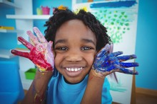 Happy African American Kid Enjoying Arts And Crafts Painting