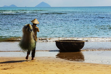 Unidentified Fishermen Is Working On The Beach In Nha Trang, Vie
