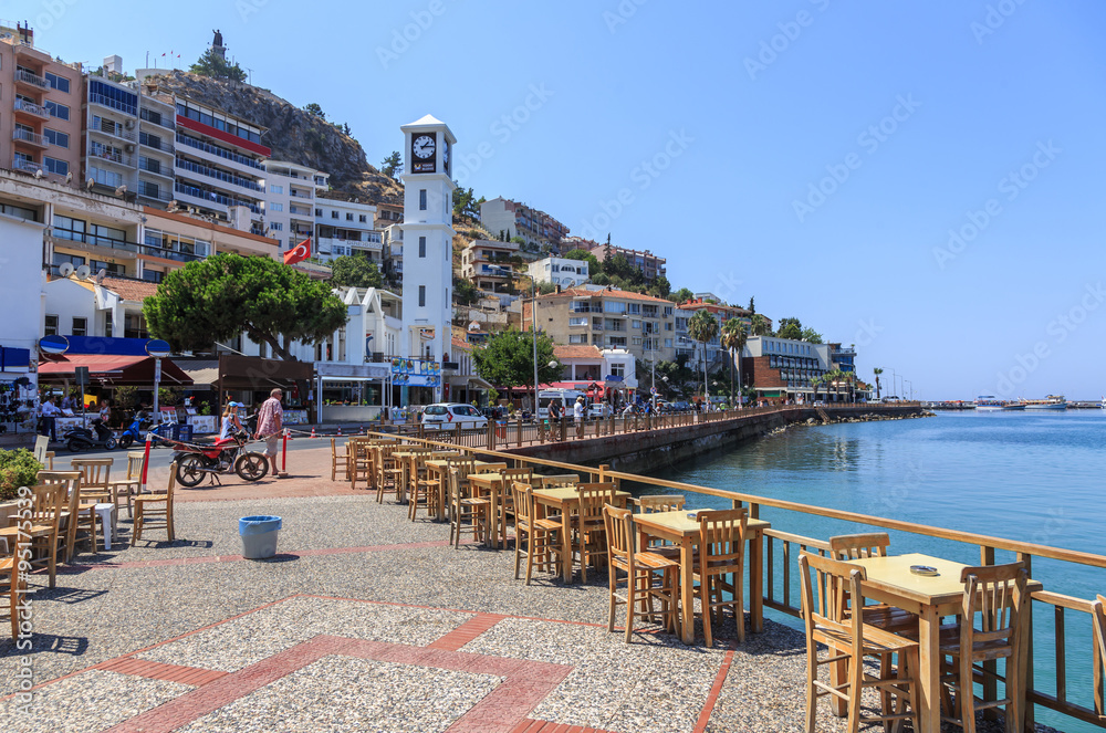 Fototapety, obrazy: Kusadasi on the Aegean Sea in Turkey - promenade and waterfront. Kusadasi is a major tourist center with modern yacht port