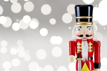 Soldier Nutcracker Statue Standing In Front Of  Christmas Lights