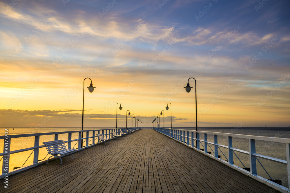 Fototapety, obrazy: wooden pier by the sea lit by stylish lamps at night