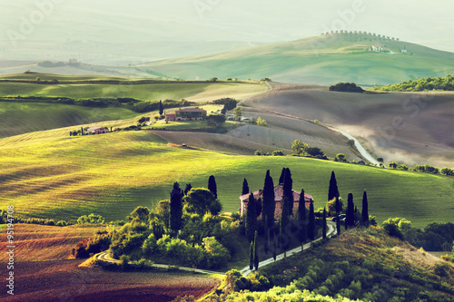 Photo Stands Khaki Tuscany landscape at sunrise. Tuscan farm house, vineyard, hills.