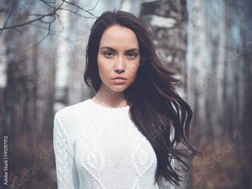 Fotografiet  Beautiful lady in a birch forest