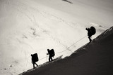 Three mountaineers walking across Mont Blanc high mountain range - 95215793