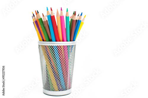 Photo Colored pencils in a pencil case on white background