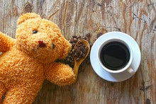 Cup Of Coffee And Bear Doll