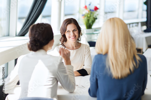 happy women meeting and talking at restaurant Canvas Print