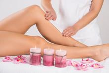 Beautician Waxing Woman's Leg ...