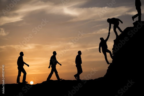 Fototapety, obrazy: Silhouette of helping hand.