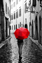 Woman With Red Umbrella On Ret...