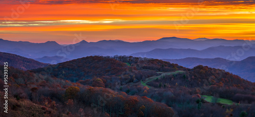 Fotografiet The surreal feel of an Appalachian Mountain sunrise on a cool autumn colorful scene along the Appalachian trail in North Carolina at Max Patch