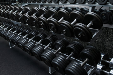 Fototapeta na wymiar Dumbbells in gym