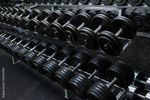 Dumbbells in gym Fotobehang
