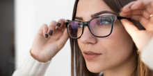 Woman Try On Glasses For Good Vision