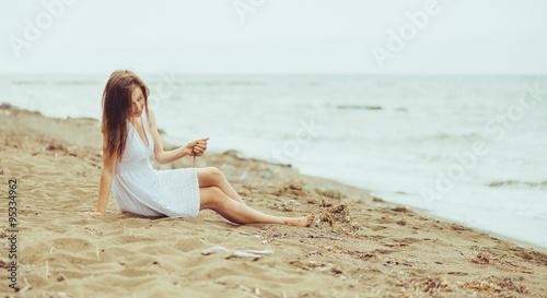 Deurstickers Ontspanning Beautiful girl resting on beach