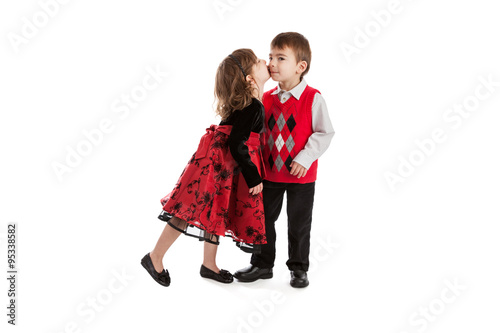 Fotografia, Obraz  3 year old fraternal boy and girl twins kissing isolated on white