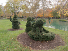 Topiary Figurines At The Pond