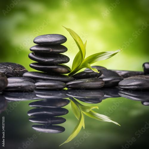 Spoed Foto op Canvas Zen still life with zen basalt stones and bamboo