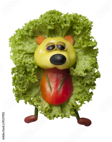 Funny hedgehog made of pepper and salad
