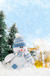 Christmas snowman with gifts on snowy background