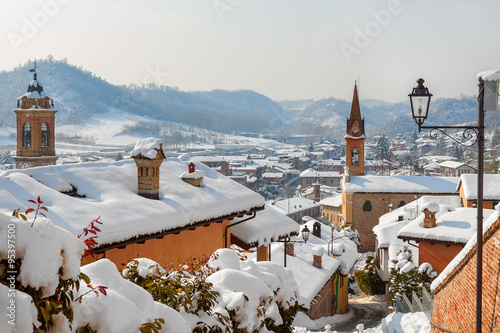 Fotografía Small town covered with snow in Italy.