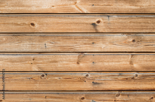 Papiers peints Bois Larch wooden planks on the building facade covered with preventive impregnation