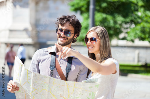 Young couple reading a map