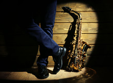 The Musician With Sax On Woode...
