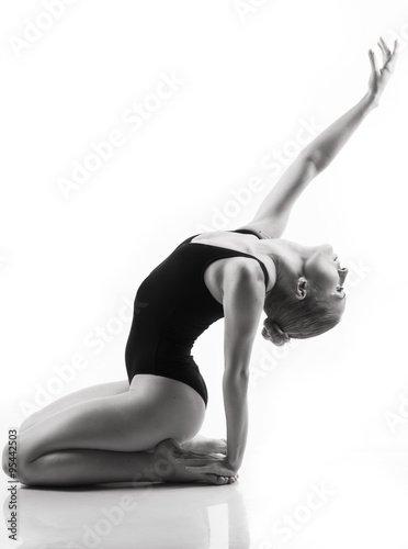 Fotografia Modern ballet dancer posing on white background